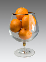 Tangerines in a glass.