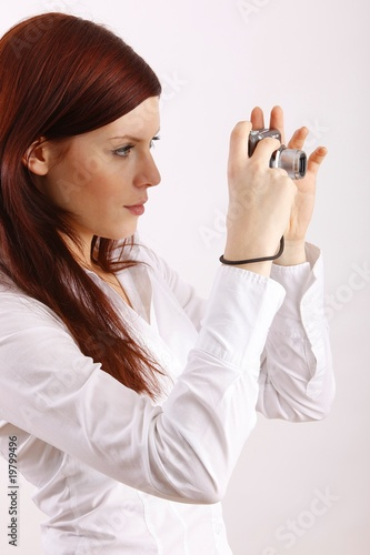 young woman with a camera