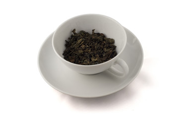 White cup with Oolong tea leafs