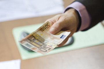 hand offering money, payments and finance