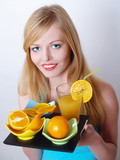 Portrait of beautiful girl with orange and juice