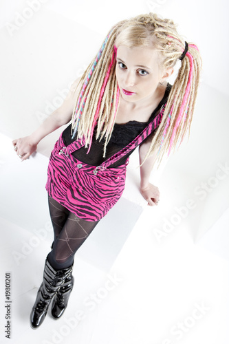 standing young woman with dreadlocks