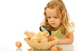 Little girl studying her easter newborn chickens