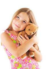Little girl taking teddy bear on white background
