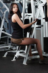 Young charming brunette in a gym
