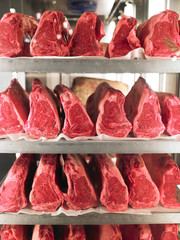 Rows of Steak on Metal Racks