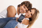 Beautiful couple with a mobile phone