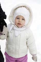 portrait of serious little girl in winter clothes
