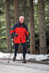 Senior during Nordic Walking in winter