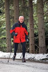 Senior during Nordic Walking in winter