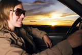 Young Woman Wearing Sunglasses Smiling and Driving poster