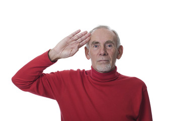 Old man saluting with serious expression