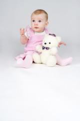 Little girl with plushy cuddle-bear.