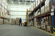 worker in blue uniform working in warehoues