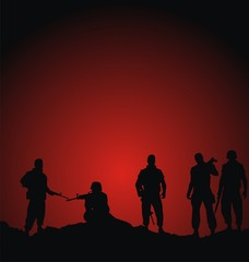 soldiers silhouettes standing against sunset background