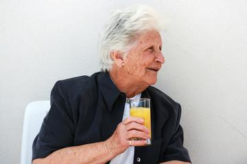 smart old lady with orange juice