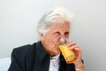old lady drinking orange juice