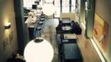 timelapse shot at a busy stylish restaurant poster