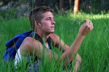 Backpacker sitting in grass