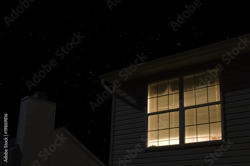 Lit window of building exterior