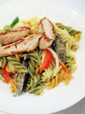 Grilled chicken breast served with pasta