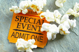 ticket stub for Special Event, with popcorn snack poster
