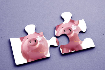 Two jigsaw puzzle pieces with piggy bank images