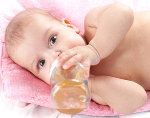 3 months adorable  baby girl drinking from plastic bottle