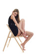 Young blonde girl sitting on a chair