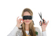 Girl wearing black band on his eyes and holding scissors