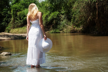 The young girl in white going on river