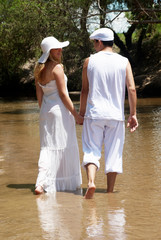 The young couple in white going on river