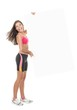 Fit fitness woman showing billboard