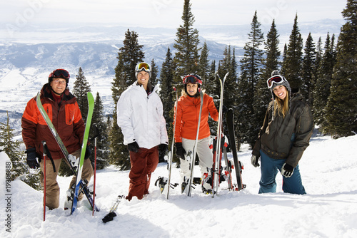Skiers Standing in Snow Smiling