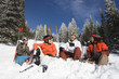 Skiers Sitting in Snow Talking