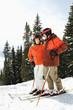 Couple on Skis on Mountain Slope