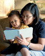 Mother Reading to Little Boy