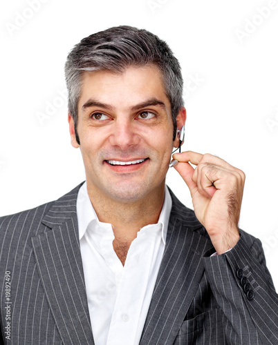 Confident businessman using headset