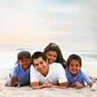 Family of Four Enjoying the Beach Sand Portrait