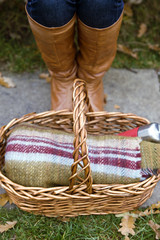 Close-up of a young woman's feet and wicker basket