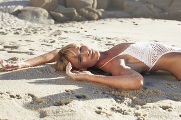 Model posing on sand