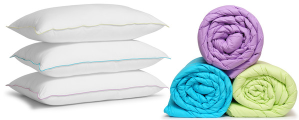 Duvets and pillows. Isolated