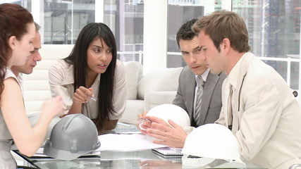 A group of architects studying blueprints