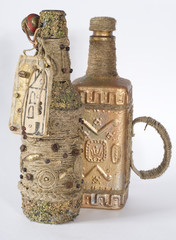 Handmade bottle decorated with hemp rope and coffee beans