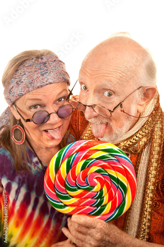 Hippie seniors licking a lollipop