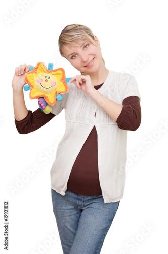 Smiling woman holding sunny toy