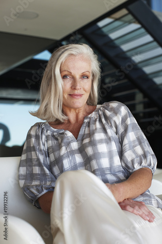 Mature woman in her house
