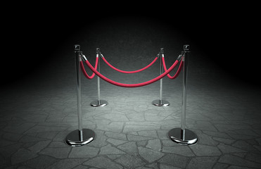 Abstract scene with stanchions and red rope.