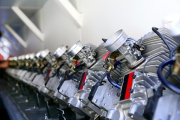 Engines from kart cars in row line for been inspected