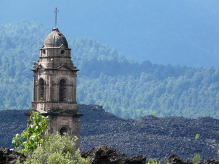 Destroyed cathedral protruding from volcanic deposits